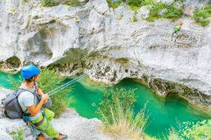Man crossing the Verdon river on a rope, Gorge du Verdon, Alpes de Haute Provence, Provence, France