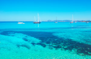 Sailing boats anchored at Ses Illetes beach, Formentera, Balearic Islands, Spain