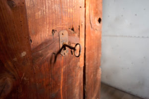 Antique wooden door with lock, close-up
