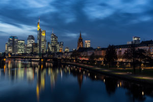 View of the Ignatz-Bubis-Bridge in Frankfurt on the skyline of the banking district