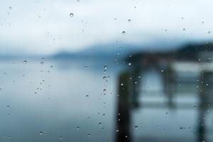 Window, raindrops, lake view