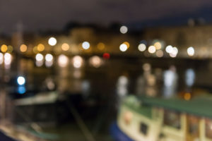 France, Paris, city view, boats on the Seine, at night, blur
