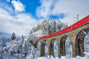 Bernina Express passes through the snowy woods around Filisur Canton of Grisons Switzerland Europe, Schmittner Viadukt