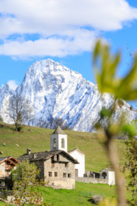 Alpine church framed by the snowy peak of Pizzo di Prata in spring Daloo Chiavenna Valley Valtellina Lombardy Italy Europe