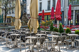 Empty tables in downtown Cologne on a Friday lunchtime at Corona times
