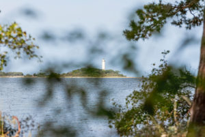 Lighthouse in the bay of Grankullaviken on Öland, foreground out of focus