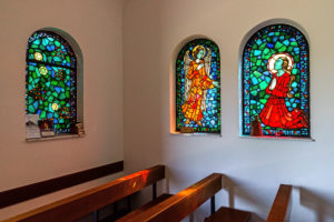 Colorful stained glass windows with religious motifs in Lady Chapel