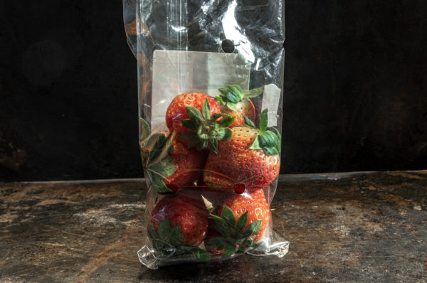 strawberrys packed in non-biodegradable plastics