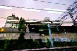 Suburban landscapes seen from inside a train of the metropolitan area of Barcelona in Catalonia Spain