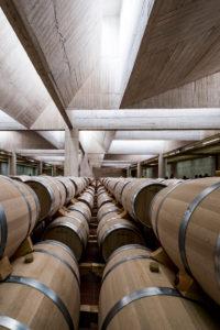 Barrels in the modern facilities of Pago de Carraovejas wine cellars of Ribera del Duero denomination of origin in Valladolid Spain Europe
