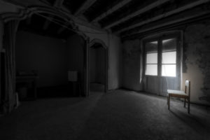 interior of an empty room with a chair and in a general state of abandonment in the city center of Barcelona in Catalonia Spain