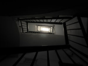 gloomy staircase in a semi-abandoned building