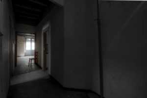 Barcelona, Catalonia, Spain, April 12: interior of an empty room with a chair and in a general state of abandonment in the city center of Barcelona in Catalonia Spain