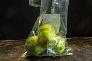 lemons packed in non-biodegradable plastics