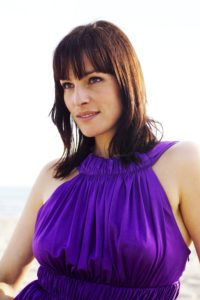Brunette woman, dress, purple, beach, half portrait,