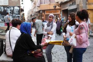 Cairo, Giza, Egypt, al-Muizz Street, Al-Muizz Al-Deen Allah Street, Old Cairo, Al Moez Ldin Allah Al Fatmi, Muizz Street, local women, talk