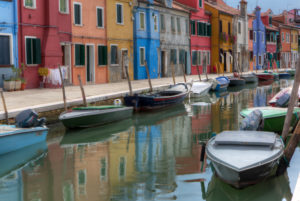 Colorful painted houses at the canal of Burano, Venice, Veneto, Italy, Europe