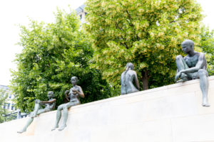 Three girls and a boy, group of figures, bronze figures, memorial, Berlin, Germany