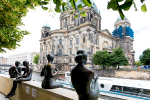 Three girls and a boy, group of figures, bronze figures, monument, Bode Museum, river, Spree, Berlin,