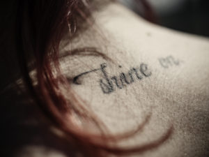 Tattoo on the neck of a girl