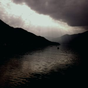 Dramatic light above the dark lake