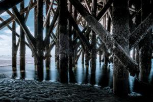 Germany, Schleswig-Holstein, Sankt Peter-Ording, beach, pole, buildings on stilts