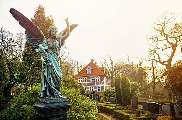 Tomb angel and parsonage of St. Pankratius in Ochsenwerder, Hamburg, Germany, Europe