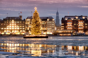 Binnenalster with Christmas tree and Michel at Christmas time in Hamburg, Germany, Europe
