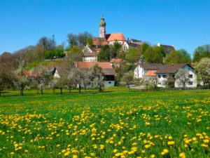 Germany, Upper Bavaria, Andechs, residential buildings and monastery church in spring