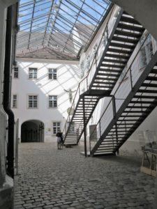 Germany, Bavaria, Andechs Monastery, inner courtyard of the monastery church, stairs