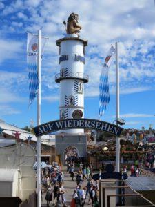 """Germany, Bavaria, Munich, Oktoberfest, Löwenbräu, beer tower with lion, beer garden, sign """"goodbye"""""""