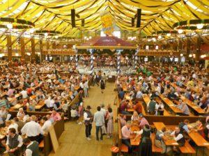 Germany, Bavaria, Munich, Oktoberfest, Paulaner marquee, interior view, guests