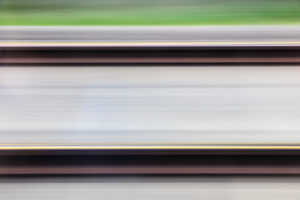 View of railroad tracks abstract from moving train