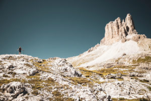 Female mountaineer, view of Tre Cime di Lavaredo Plateau from Innerfeldtal Valley, Dolomites, South Tyrol, Italy