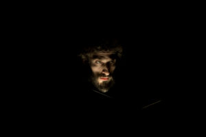 Man with beard, darkly, look illuminateded, portrait