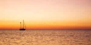 A boat on the Ijsselmeer near the lighthouse Paard van Marken on the dutch peninsula Marken