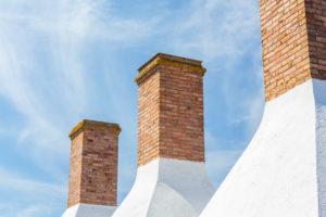 Chimneys of a smokehouse in Snogebæk, Europe, Denmark, Bornholm,