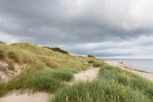 Dark clouds over the beach of Vester Sømarken, Europe, Denmark, Bornholm,