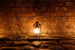 oil lamp on the bridge of the Hammershus castle ruin (13th century) during a lighting exercise, Europe, Denmark, Bornholm,