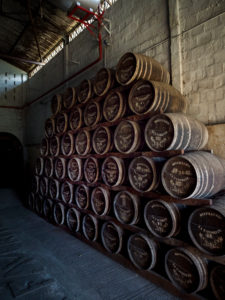 Habitation la Favorite, rum distillery, barrels, distillation with steam engine same as 100 years ago