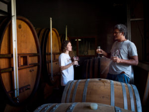 Neisson Rhum, rum warehouses, wooden barrels, woman, man, taste