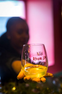 Rhum JM, distillation Rhum JM, tasting room for visitors, woman, hand, glass,