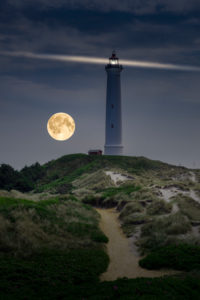 Denmark, Jutland, Ringkøbing Fjord, dune path at the lighthouse Lyngvig Fyr with full moon.