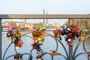 "Germany, Hesse, Frankfurt, love locks on the bridge ""Eiserner Steg""."