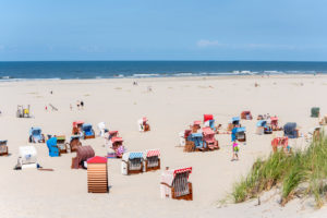 Germany, Lower Saxony, East Frisia, Juist, main beach with beach chairs.