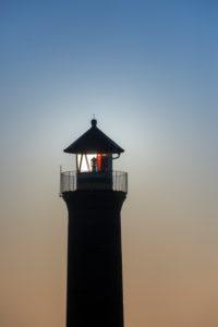 """Deutschland, Niedersachsen, Ostfriesland, Juist, """"Memmertfeuer"""" der Leuchtturm ausser Funktion am Hafen."""