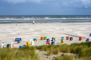 Germany, Lower Saxony, East Frisia, Juist, the beach with beach chairs.