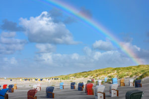 Germany, Lower Saxony, East Frisia, Juist, rainbow on the beach.