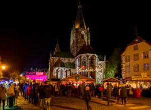 France, Alsace, Wissembourg, Christmas market at the Abbey Church of St. Peter and Paul.