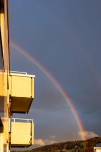 Germany, Baden-Wuerttemberg, Karlsruhe, rainbow at a residential complex.